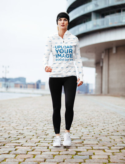 Sublimated Hoodie Mockup of a Woman in Activewear Walking by a Building 41368-r-el2