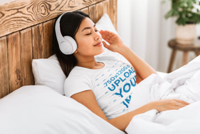 T-Shirt Mockup of a Woman Listening to Music in Bed 39772-r-el2