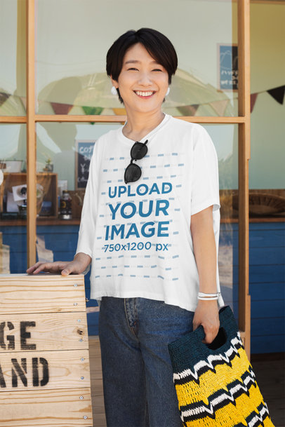 Mockup of a Happy Woman Wearing a Unisex T-Shirt Outside a Store 39715-r-el2
