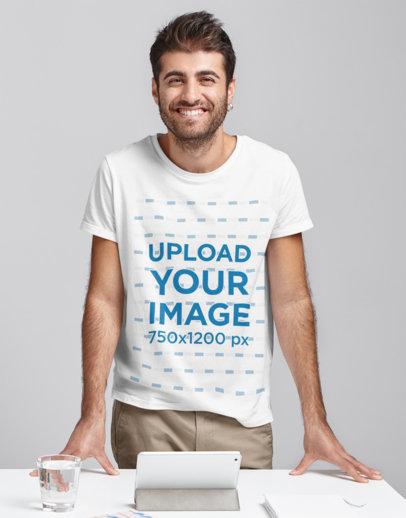 T-Shirt Mockup of a Man Standing Behind a Desk m2919-r-el2