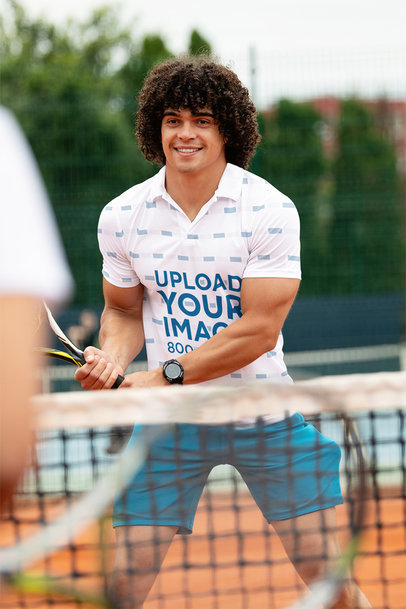 Polo Shirt Mockup of a Muscular Man Playing Tennis m2785-r-el2