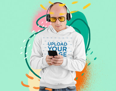 Hoodie Mockup of a Man Listening to Music with an Illustrated Backdrop 5236-el1