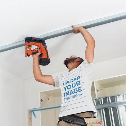 T-Shirt Mockup Featuring a Man Installing an Aluminum Frame m3857-r-el2