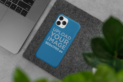 Mockup of a Phone Case Placed on a Surface Next to a Computer 5164-el1