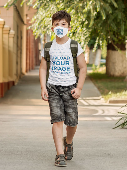 Mockup of a Boy Walking to School Wearing a Face Mask and a T-Shirt m3183-r-el2