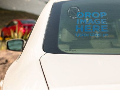 Square Window Decal Mockup on the Back Window of a White Sedan Car a15352