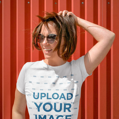 T-Shirt Mockup Featuring a Woman With Sunglasses Holding Up Her Hair m5096-r-el2