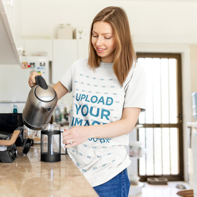 T-Shirt Mockup of a Woman Making Coffee at Home m5134-r-el2