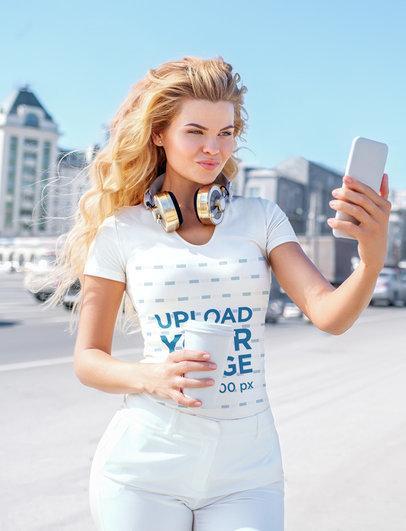 V-Neck Tee Mockup of a Blonde Woman Taking a Selfie on a Street 39041-r-el2
