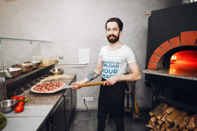 T-Shirt Mockup of a Happy Man Making a Pizza 42694-r-el2
