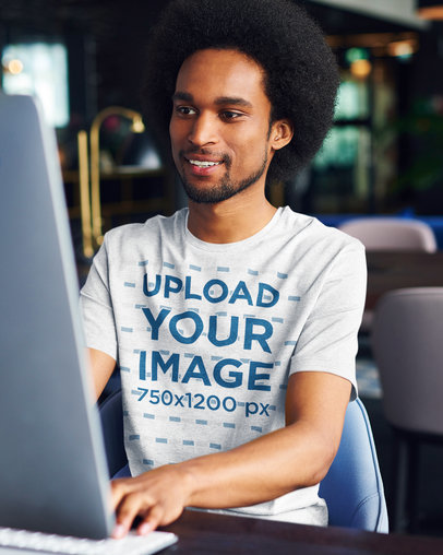Heather T-Shirt Mockup of a Happy Young Man Working at an Office 40228-r-el2