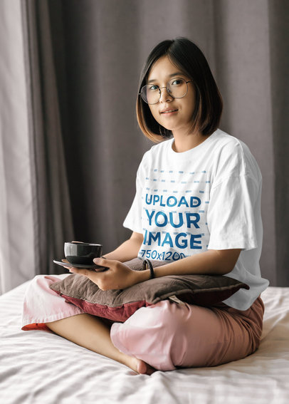 Oversize T-Shirt Mockup of a Woman with Glasses Having Tea on Her Bed m4668-r-el2