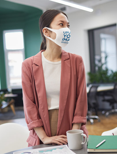 Mockup of a Woman Wearing a Face Mask at the Office M3715-r-el2