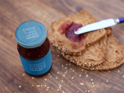 Label Mockup of a Jam Jar on a Kitchen Counter Next to Some Bread Slices a7263