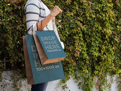 Paper Bag Mockup of a Woman Carrying Two Shopping Bags a6683