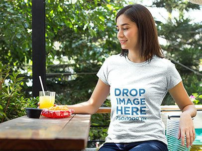 Girl Having Lunch at a Local Cafe T-Shirt Mockup a8614
