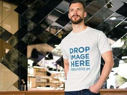 Mockup of a Bearded Man Wearing a Tee in a Restaurant a8590
