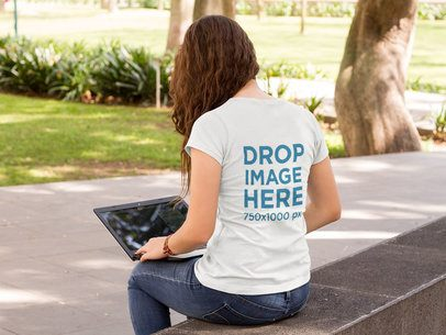 Girl at a Campus Working while Wearing a Round Neck Tee Mockup from the Back a9182b