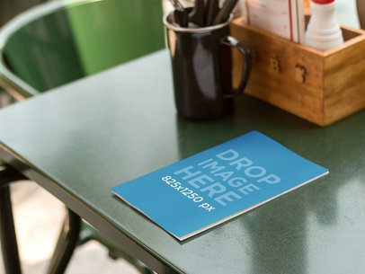Bifold Brochure Mockup of a Menu Lying on Top of Table a10319