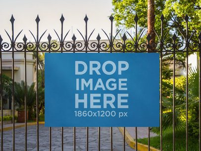 Banner Mockup on a Fence at a Fancy House a10496