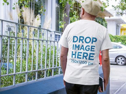 Man Wearing a Tshirt Mockup while Waiting for Someone on the Street a10850b