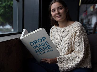 Hardcover Book Mockup of a Young Woman at Home Reading a12027