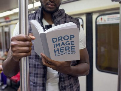 Book Mockup Featuring a Man Reading on the Metro a12036