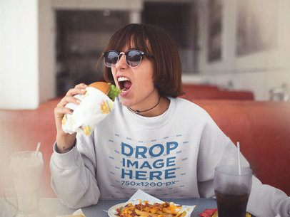 Crewneck Mockup of a Trendy Girl with Sunglasses and Short Hair Eating a Burger a12658