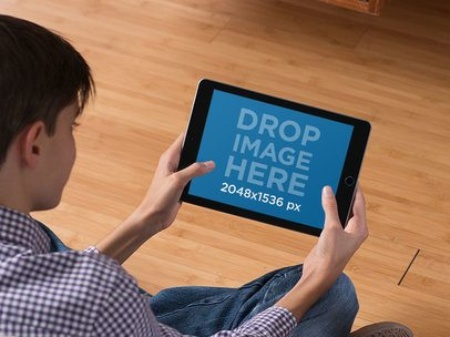Pair of Teenagers at Home Playing on Their iPad Mini Mockup in Landscape Position a13056