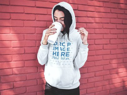 Pullover Hoodie Mockup of a Trendy Girl Drinking Coffee in the Morning a13179