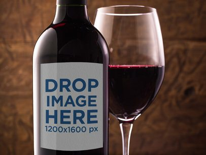 Closeup of a Red Wine Bottle Mockup With a Served Glass a14680
