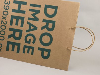 Close Up Template of a Paper Shopping Bag On a White Surface a14720