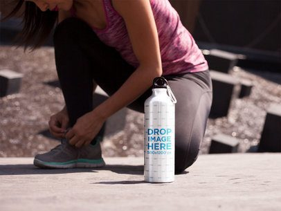Aluminum Water Bottle Template Standing Near a Girl Tiding up her Shoes a14883