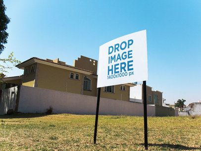 Real Estate Lawn Sign Mockup in a Back Garden of a House a14983